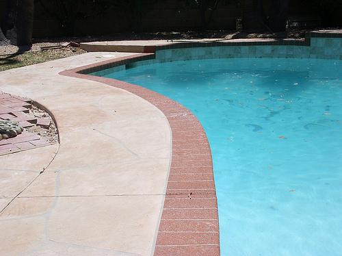 Custom Acrylic Bordered Pool Deck by Advanced Deck Designs